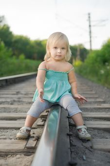 Free Adorable Girl Sit On Rail Look To Camera Royalty Free Stock Photos - 20305178