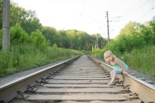 Free Adorable Girl Sit On Rail Wait For Train Stock Images - 20305184