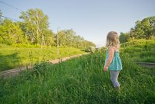 Free Adorable Girl Stay On Hill And Look To Train Royalty Free Stock Photography - 20305247