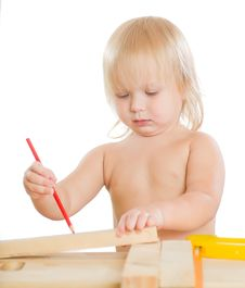 Free Baby Work With Wood And Saw In Workshop Room Royalty Free Stock Photography - 20305297