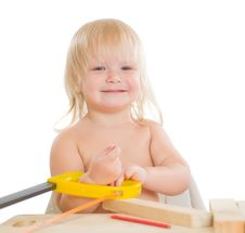 Free Adorable Girl Work With Wood And Saw In Workshop Royalty Free Stock Image - 20305316