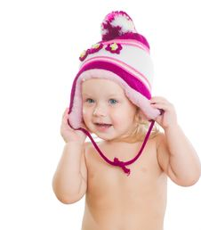 Free Adorable Girl Putting On Winter Hat On Head Stock Images - 20305384