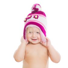 Free Adorable Girl Putting On Winter Hat On Head Royalty Free Stock Photos - 20305388