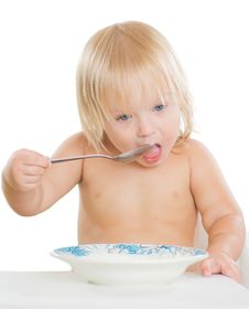 Free Adorable Toddler Girl Eat Porridge Stock Photography - 20305452