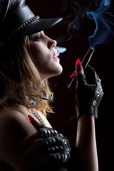 Beautiful Girl With A Cigar Royalty Free Stock Photography