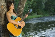 Free Young Woman Playing Guitar Royalty Free Stock Photography - 20306947