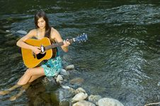 Free Young Woman Playing Guitar Stock Photos - 20307063