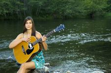 Free Young Woman Playing Guitar Stock Images - 20307164