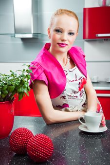 Free Blond Girl In Interior Of Red Modern Kitchen Stock Photos - 20307253