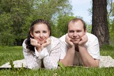 Free Couple Lays Together On A Grass Stock Photo - 20309590