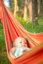 Free Adorable Baby Relaxing In Hammock Stock Image - 20312101
