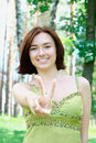 Free Portrait Of A Beautiful Girl With Two Fingers Up Stock Images - 20319684