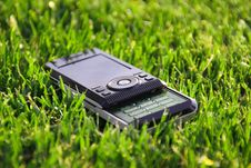 Free Mobile Phone On The Grass Stock Images - 20310664