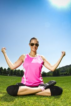 Free Young Woman On The Freshly Cut Grass Stretching Royalty Free Stock Photo - 20311225
