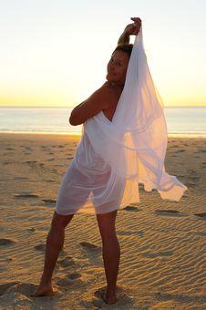 Mature Woman Beach At Sunset Stock Image
