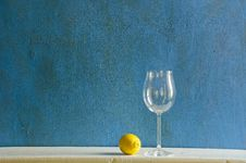 Still-life With Lemon And Empty Wineglass Royalty Free Stock Photography