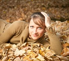 Free Young Woman In Autumn Leaves Royalty Free Stock Image - 20316486