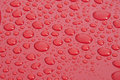 Free Water Droplet On Red Surface Stock Images - 20322644