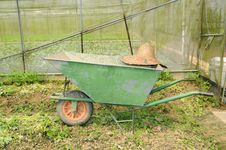 Free Wheel Barrow And Farmer Straw Hat Royalty Free Stock Photo - 20321575