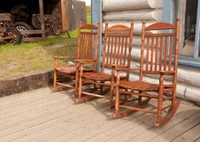 Three Rocking Chairs Royalty Free Stock Image