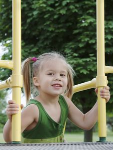 Girl At The Playground Stock Photo