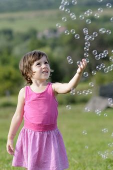 Free Pretty Child Catching Balloons Royalty Free Stock Image - 20322866
