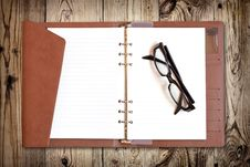 Free Eyeglasses On Notebook Royalty Free Stock Images - 20324249