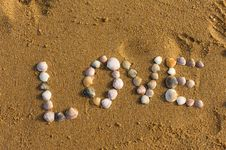Love Symbol Written On Sand With Shells Royalty Free Stock Photos