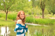 Girl Walking By The Pond Royalty Free Stock Image