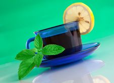 Free Nice Cup Of Tea And Mint On Green Background Royalty Free Stock Image - 20335576