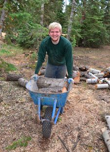 Free Teenage Boy With A Wheelbarrow In The Forest Stock Photography - 20338622