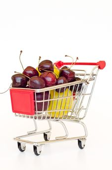 Free Shopping Cart With Plum And Cherry Stock Images - 20339054