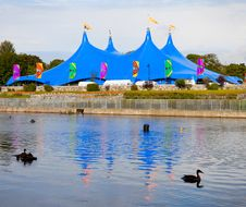 Free Circus Style Blue Tent On The Bank Of The River Royalty Free Stock Photos - 20339908
