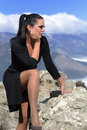 Free Woman In Black Dress Sitting On A Rock Royalty Free Stock Photo - 20345935