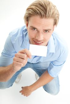 Free Happy Blond Man With Giving Card Stock Photos - 20347383