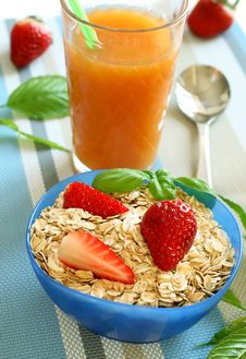 Oats And Strawberry In Bowl And Glass Of Juice Royalty Free Stock Image