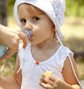 Free Little Girl Dring Water In The Park. Royalty Free Stock Image - 20357896