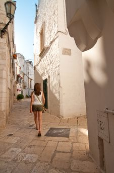 Free Girl In A Narrow Street Royalty Free Stock Photo - 20350185