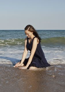 Beautiful Young Girl In Black Wet Dress Stock Image