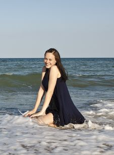 Beautiful Young Girl In Black Wet Dress Stock Photography