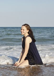 Beautiful Young Girl In Black Wet Dress Royalty Free Stock Photography