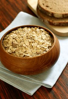 Oats In Wooden Bowl And Bread On Table Royalty Free Stock Image