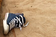 A Sneaker In The Sand Stock Photography