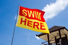 Free Swim Here Flag Next To Lifeguard House Stock Photos - 20356883