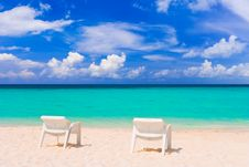 Free Chairs On Tropical Beach Royalty Free Stock Photography - 20357637