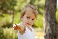 Little Girl Show You A Cracker In The Park. Royalty Free Stock Photo
