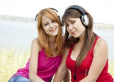 Free Two Teenage Girls Listening To Player Royalty Free Stock Photos - 20358008