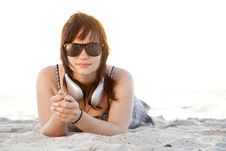 Free Girl With Headphones At Beach Sand. Royalty Free Stock Photography - 20358187