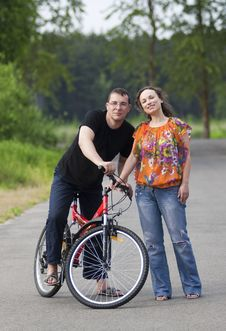 Happy Couple At Bicycle Royalty Free Stock Photo