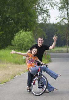 Happy Couple At Bicycle Stock Photography